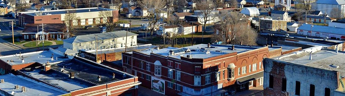 This picture is a view from the top of the courthouse overlooking the roof tops of downtown businesses and you can see the Taylorville Fire Department building in the background.